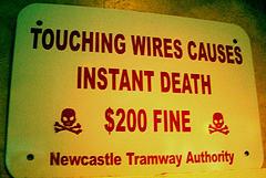 Warning symbolizing illegal trademark usage.