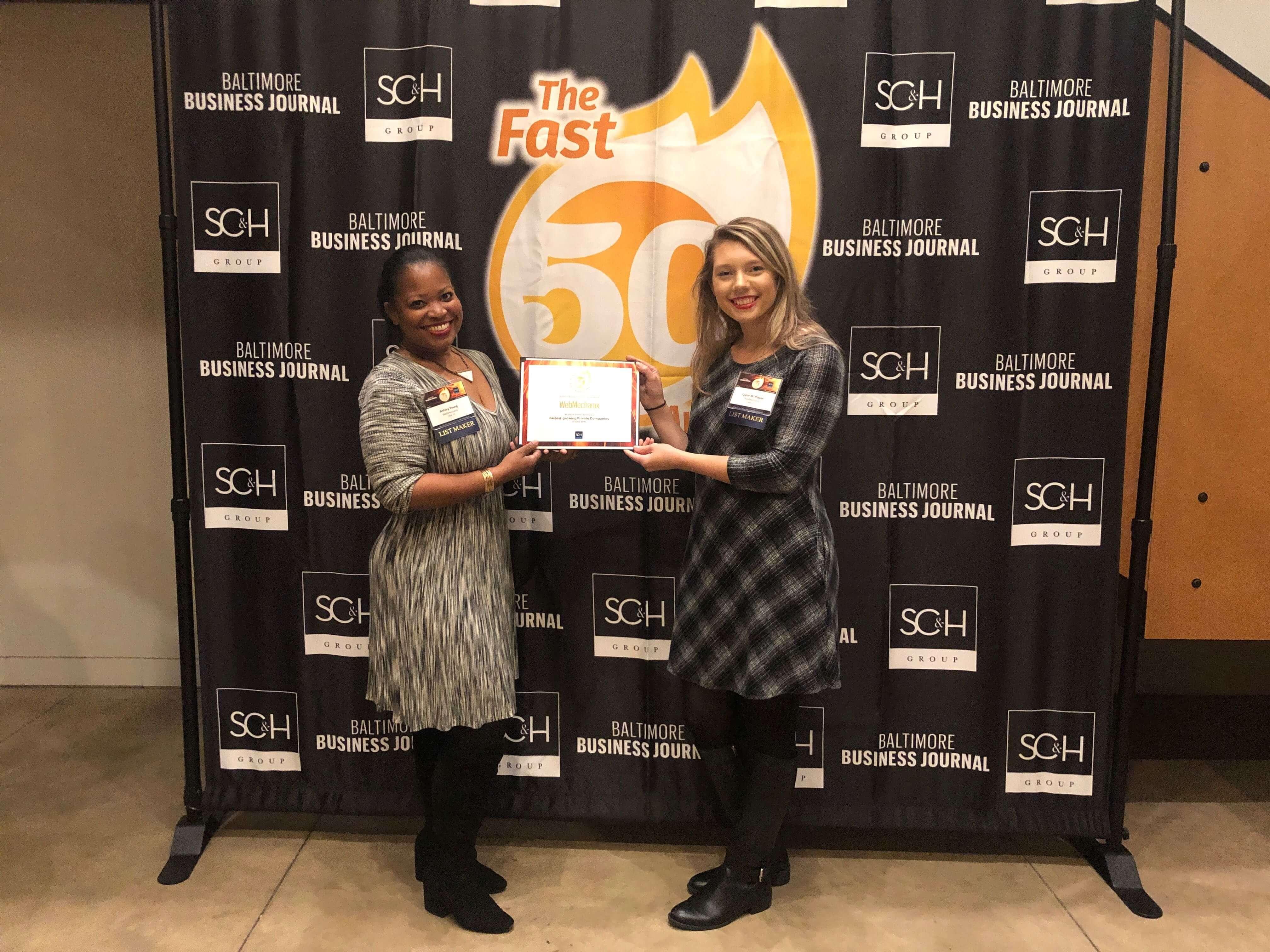WebMechanix accepts fastest growing company award